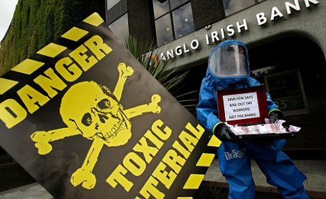 Toxic shock: Protestors railed against the banking crisis at the Anglo Irish Bank in Dublin this summer