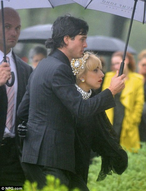 Moral support: Lady Gaga was accompanied by her boyfriend Luc Carl to her grandfather Giuseppe Germanotta's funeral