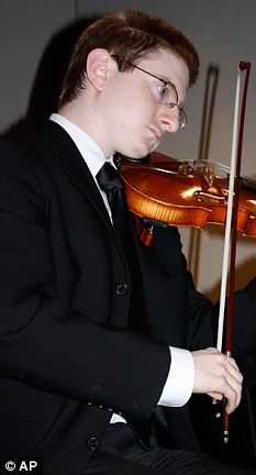 Musician: Mr Clementi performing with the Ridgewood High School Orchestra at a charity dinner last year