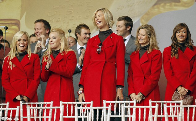 Standing tall: Angie Watson has the best view in the house as she and the other US team WAGs watch the opening