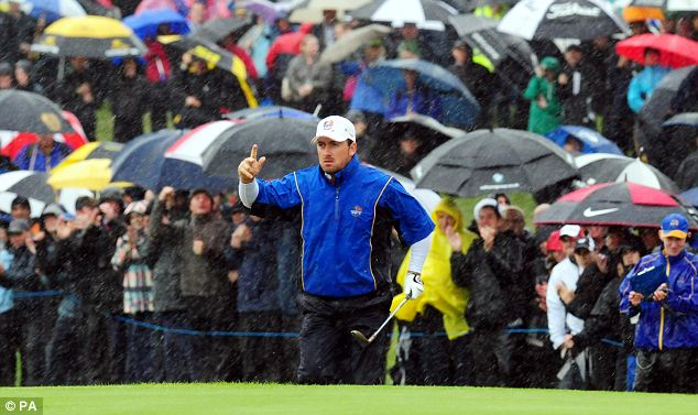 Early pacesetter: Europe's Graeme McDowell celebrates going one up in the fourth in the rain