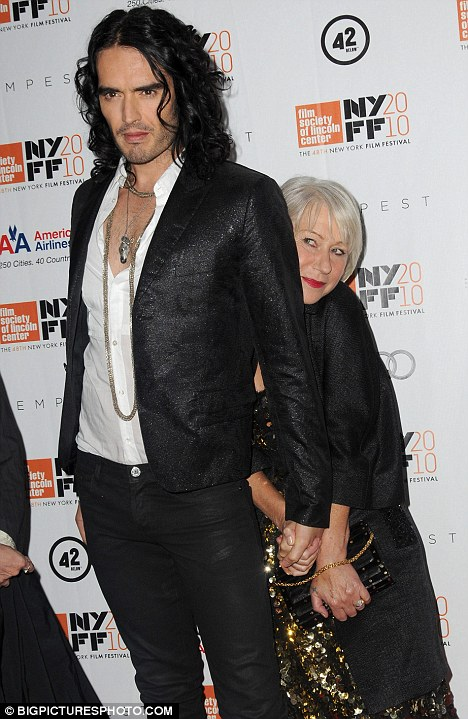 Acting up: Russell Brand and Helen Mirren put on an amusing display on the red carpet for the premiere of their new film The Tempest in New York last night