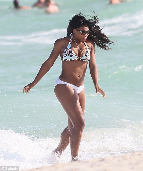 Looking good: Serena Williams showed of her newly svelte figure in a mismatched bikini on Miami Beach today