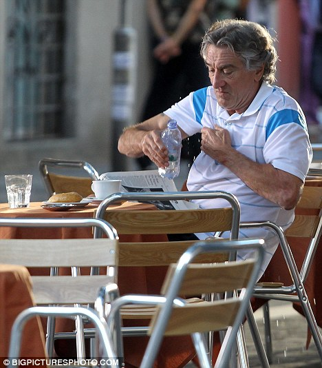 On location: Meanwhile De Niro refreshes himself at a cafe with some water