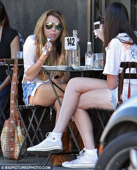Brunch style: Yesterday the teen star grabbed a bite to eat with a friend  wearing Native American style boots at cafe Joans On Third in West Hollywood