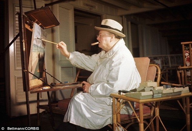 Winston Churchill is pictured at his easel