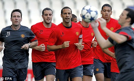 Guidance: Smalling (right) says he is learning from Rio Ferdinand (centre)