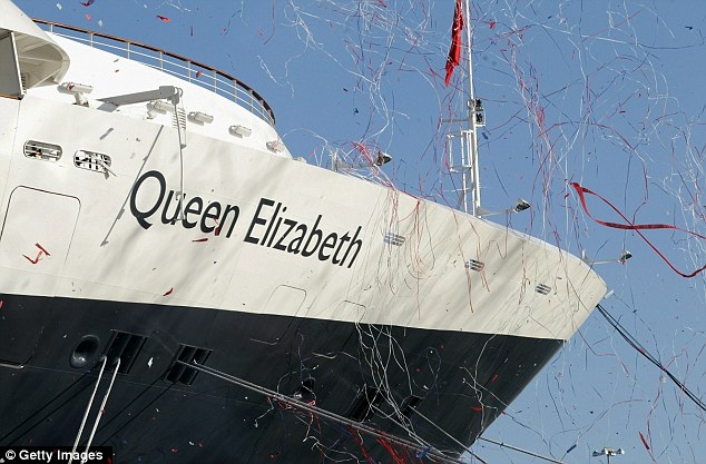Bunting drops over the bow of Cunard's new cruise-liner Queen Elizabeth II after it was named by Queen Elizabeth II in Southampton Docks on October 11, 2010 in Southampton, England