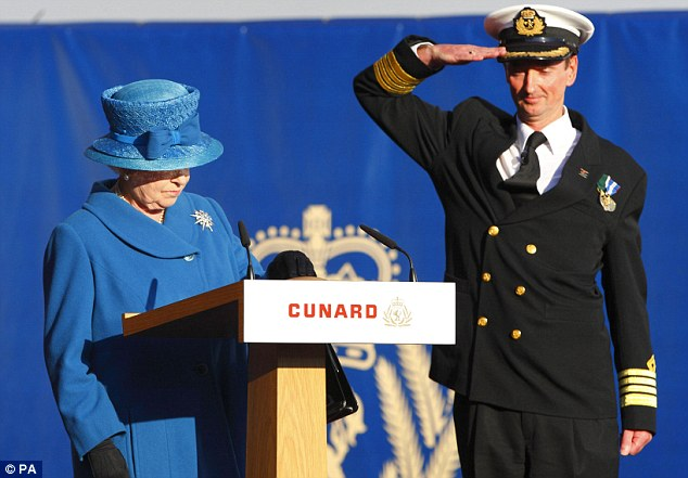 Christopher Wells, Captain of the Queen Elizabeth, salutes as the Queen presses a button to release the bottle of white wine to smash on the side of the bow of Cunard's newest cruise ship in Southampton