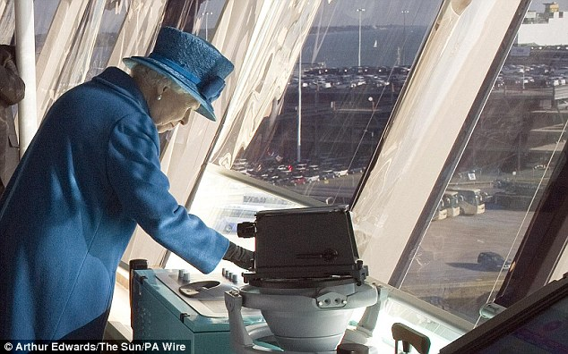 The Queen presses the ship's siren during a tour of the Queen Elizabeth, prior to the naming ceremony