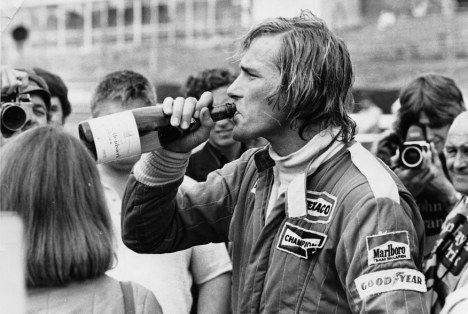 Lapping it up: Hunt swigging champagne at Brands Hatch after breaking a lap record