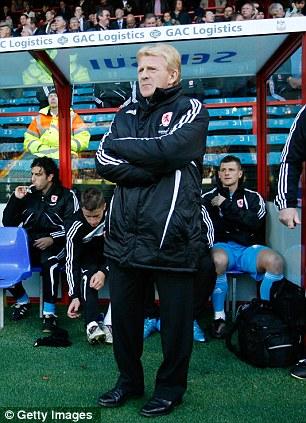 Glum: Boro boss Gordon Strachan faces a fight to keep his job at Middlesbrough
