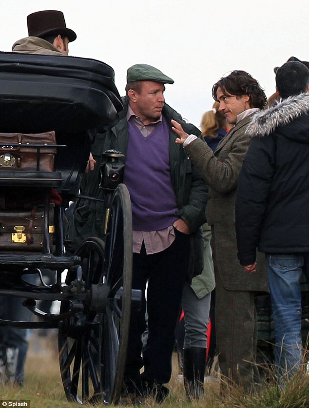 What's your motivation?: Director Guy Ritchie and Jude look on as Robert gives his view about the way a scene should be shot