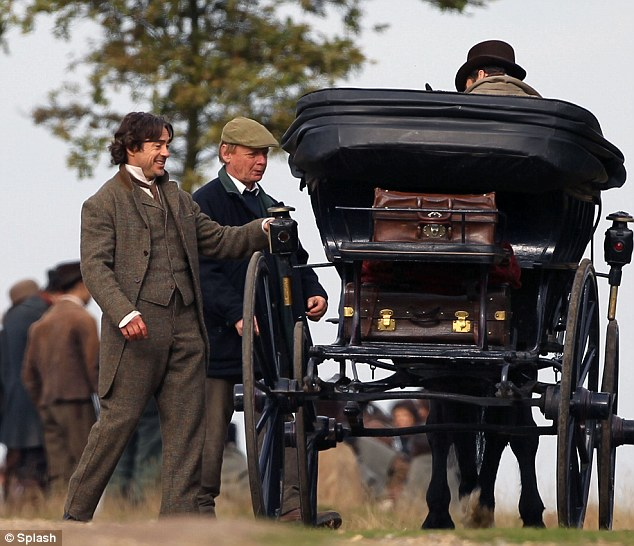 Home, James: Robert laughs as the carriage owner looks on worriedly