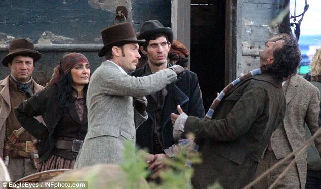 Take that: Jude Law as Dr Watson punches a bounder in scenes for the Sherlock Holmes sequel shot in Richmond Park, south-west London