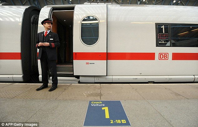 A train guard by the train which Deutsche Bahn wants to prove it can run safely through the Channel Tunnel