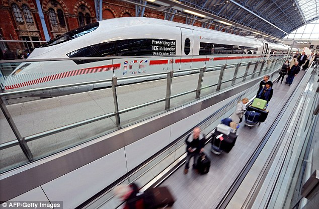 Eurostar passengers pass the ICE high speed train at St Pancras this morning
