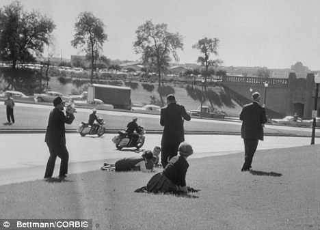 Members of the public duck for cover after JFK is shot dead by a sniper in Dallas, Texus