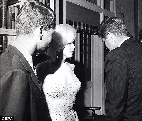 Bobby Kennedy (left), joins Marilyn Monroe (centre) and JFK (right). The new book dismisses the notion that President Kennedy had an affair with the Hollywood star