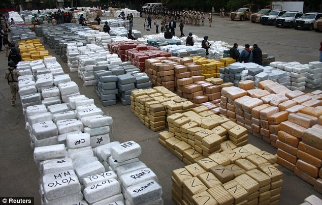 Blow to the bad guys: Some of the tonnes of packages of marijuana on display at a military base in Tijuana. The seizure, the largest in Mexico's history, is believed to be a blow to the Sinaloa cartel