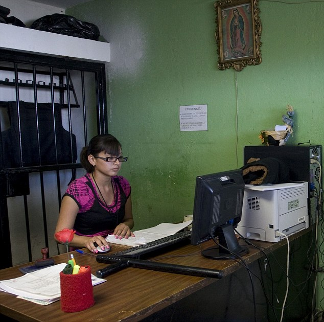 Steep learning curve: Criminology student Marisol Valles Garcia, 20, works in her office in the municipality of Praxedis G Guerrero, located in one of the most violent regions of Mexico during her first day on the job on Monday