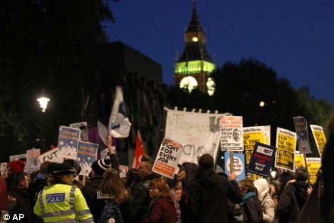 Thousands of people gathered outside Downing Street in London to protest against spending cuts last night