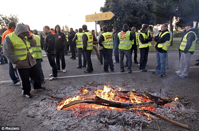 Blockade: Striking workers block access roads to the Marseille-Provence airport days before voting on pension reform