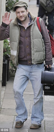 Dannii's boys: Matt Cardle arrived with his guitar in hand while Aiden Grimshaw was all wrapped up against the cold