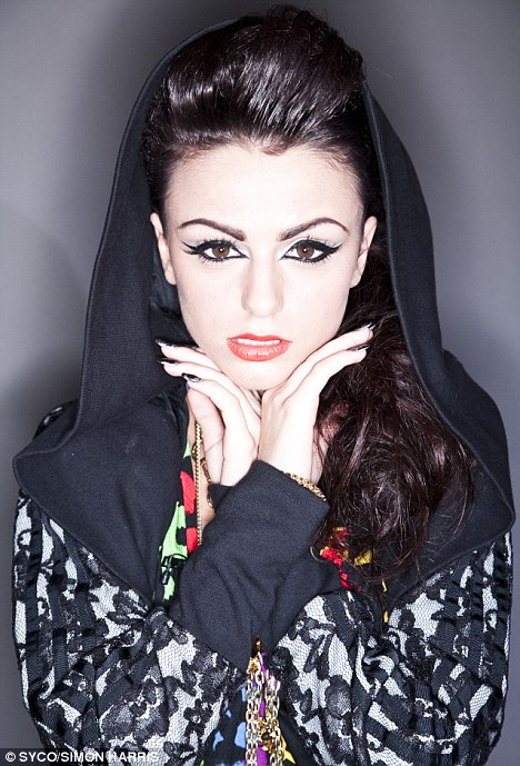 Strike a pose: Cher is a ringer for her mentor Cheryl, seen here with heavy eye make-up and a hooded top for a photoshoot