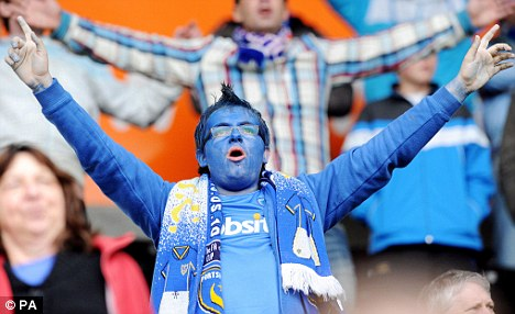 Saved? Portsmouth fans were in full voice against Hull despite their uncertain future