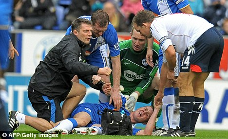 Hospital pass: Wigan's James McCarthy lies injured after a being sold short by team-mate Antolin Alcaraz