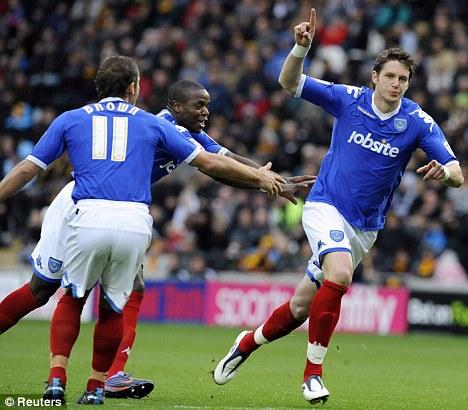 Reprieve: Greg Halford celebrates scoring against Hull on Saturday