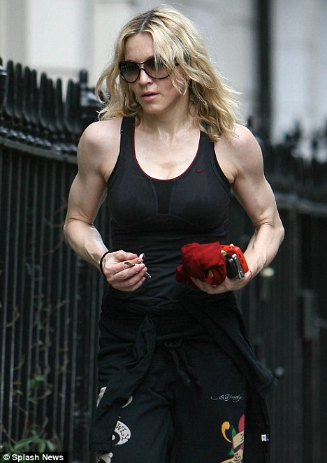 'Queen of Pop' Madonna walks back to her London home after a Saturday gym session, looking 'pumped-up'.