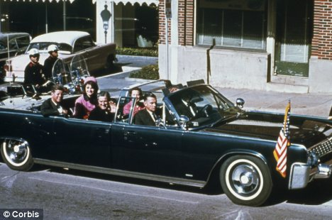 President John F. Kennedy and his wife, Jacqueline Kennedy are pictured riding in the motorcade in Dallas, Texas, moments before his assassination
