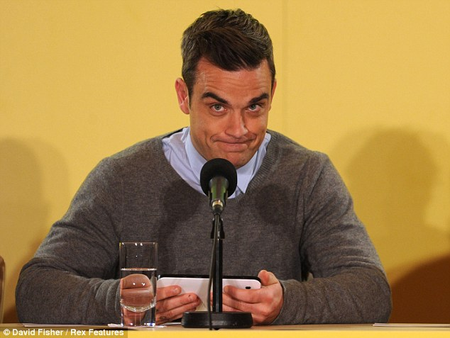 Back in the fold: The tour will feature all the band's hits plus songs from Robbie's solo career