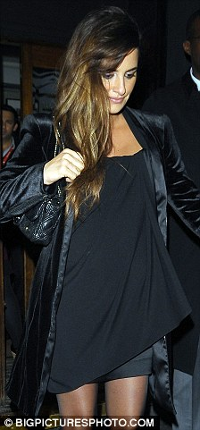 Looking swell: Penelope's burgeoning bump was clear to see under her black minidress