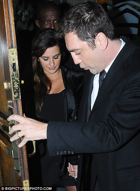 What a gentleman: Javier holds the door open while holding tightly to his pregnant wife