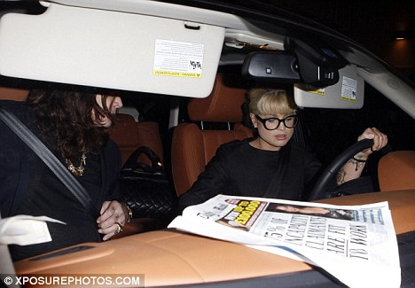 Excellent taste: Kelly and father Ozzy were seen leaving Beverly Hills restaurant Shanghai Grill with a copy of the Daily Mail in their car