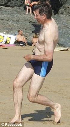 Sir John Sawers, chief of MI6, on holiday on a West Country beach