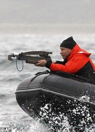 Macho man: Vladimir Putin when he rode topless and shooting whales