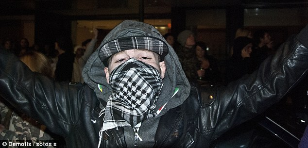 Violence: A hooded youth with his face covered outside the illegal rave in High Holborn where seven people were arrested