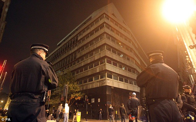Stand off: Police kept watch on Museum Street as the rave continued through the night