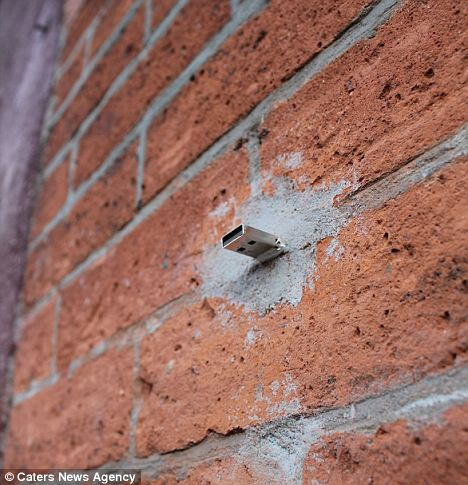 One of the USB sticks that has been cemented into a wall in New York