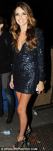 Buy my song! Nadine looked upbeat and positive as she left Koko after appearing on The Album Chart Show