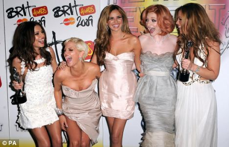 Going solo: Nadine has so far notched up 2,439 digital downloads for her song, while bandmate Cheryl Cole (left, pictured with the rest of the group) achieved 157,000 for her new single