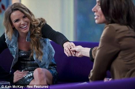 Flashing her bling: Nadine shows off her engagement ring to Daybreak host Christine Bleakley