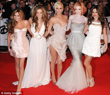 Bandmates: Kimberley said she is 'bored' of reports of a feud between Nadine and the rest of Girls Aloud, seen here at the BRIT Awards in 2009