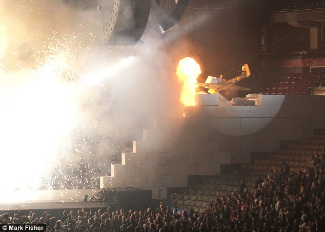 A fibreglass Stuka crashes into the stage during The Wall