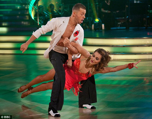 Red hot: Kara Tointon and her partner Artem Chigvintsev opened the show with a sexy salsa