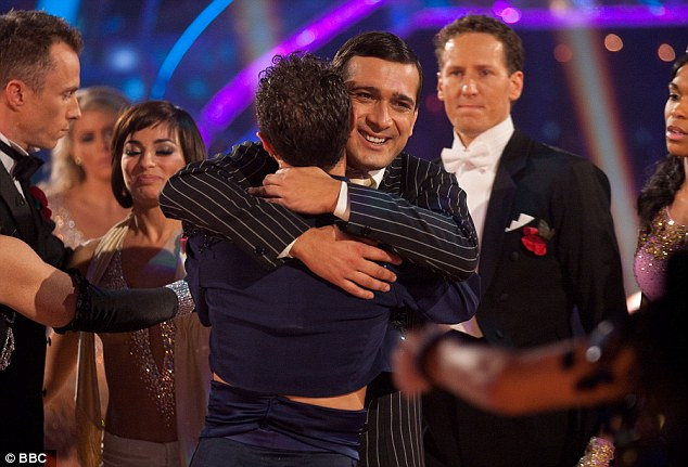 Saying goodbye: Jimi hugs dancer Vincent Simone after being voted off the show